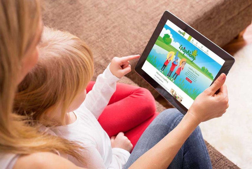 young child viewing leapalong website on tablet