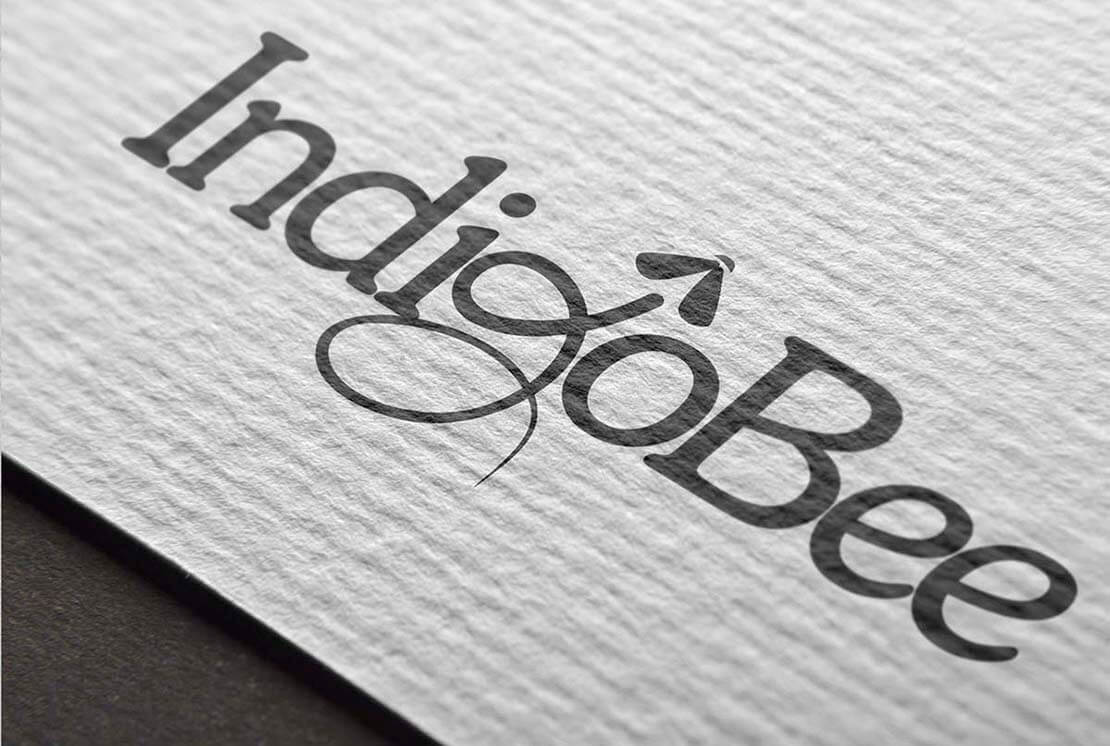 close up of indigobee logo on letterhead
