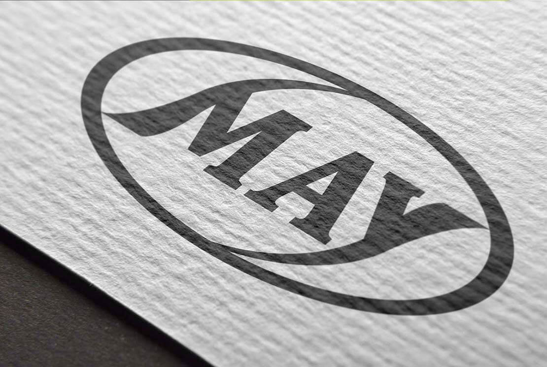 close up of may logo on textured paper